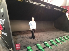 Taken in 2012, this is Frances standing in the bucket of a wheel loader at MinExpo, a trade show.